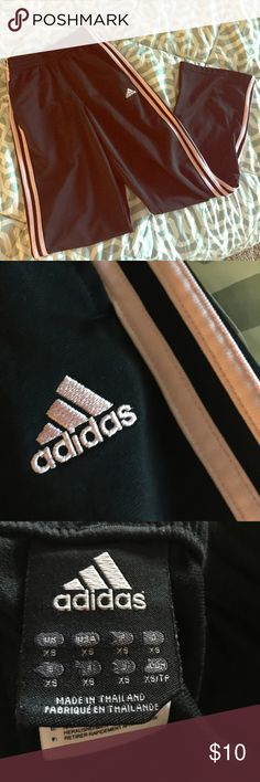 Awesome Adidas black and pink stripped track pants Shiny black with light pink strips Adidas track pants.  In EUC.  Size is XS. Adidas Pants Track Pants & Joggers
