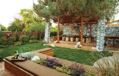 """Jamie Durie created several """"settings"""" in this Wyoming backyard, including a dining area, a lounge area and an open yard for play."""