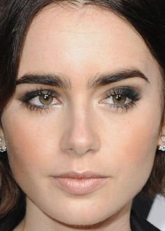 Close-up of Lily Collins at the Saint Laurent fall 2016 show. http://beautyeditor.ca/2016/02/24/saint-laurent-fall-2016-show