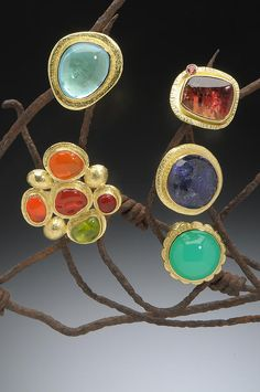 Assorted 18K Gold Cocktail Rings Clockwise: Blue Topaz; Pink Tourmaline with Orange Sapphire; Tanzanite; Chrysophrase; Mexican Jelly Opals and Peridot with 18K Gold Domes-Hughes-Bosca Jewelry | Rings