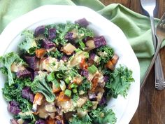 This hearty kale salad has caramelized roasted sweet potatoes and a rich ginger peanut dressing.