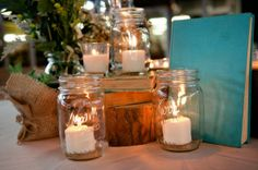 Centerpiece ideas: Candles, old books, tree stumps, burlap. Lovely combo.