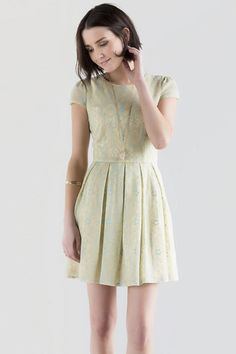 """We are loving the vintage feel of the Arielle Lace Dress. Yellow & blue lace make up this pleated cap sleeve dress. Statement earrings & a pair of heels finish off this look.<br /> <br /> - 34"""" length from shoulder to hem<br /> - 36"""" chest<br /> - 26"""" waist<br /> - 66"""" sweep<br /> - measured from a size small<br /> <br /> - Shell: 60% Nylon, 40% Cotton; Lining: 100% Polyester<br /> - Hand Wash<br /> - Imported"""