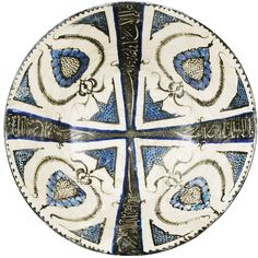 A KASHAN BLUE AND BLACK DECORATED POTTERY BOWL, PERSIA, EARLY 13TH CENTURY
