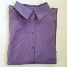 Purple Button Down Lilac. Color is lighter than in photos. 60% cotton. 35% polyester. 5% spandex. Update later. Avenue Tops Button Down Shirts