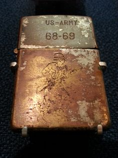 "For the servicemen and women in Vietnam during the war years between 1965 and the early 1970's, Zippo lighters became a form of personal expression, often inscribed with sentiments or sketches expressing feelings about war, conflict, and thoughts of home. Sometimes referred to as ""trench art,"" these lighter are a barometer of the times in which they were made. Currently located at the Zippo/Case Museum."