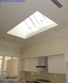 This Peppermint Grove house underwent extensive renovation and extensions by Peter Bodeker Constructions.  During the works, Clearview Skylights installed 3 M04 Velux Skylights to the kitchen side by side, the central skylight being electric opening and the left and right skylights fixed. The Velux Skylights are an impressive feature to the kitchen.  VELUX Skylights Perth