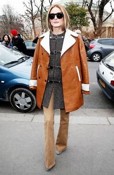 Olivia Palermo doubles up on outerwear with a herringbone jacket and a brown leather coat on top