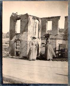 Two women standing near the ruins of a building at Green and Gough streets  San Francisco History Center, San Francisco Public Library