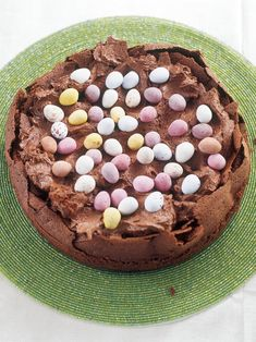 Easter Egg Nest Cake - - (Flourless) - - -   Cake : 250 grams dark chocolate (chopped), 125 grams unsalted butter (softened), 6 medium eggs (2 whole, 4 separated), 175 grams caster sugar (75g / 1/3 cup for yolk mixture, 100g / 2/3 cup for whites), 1 teaspoon vanilla extract. Topping : 125 grams dark chocolate (chopped), 250 millilitres double cream, 1 teaspoon vanilla extract, 1 packet chocolate mini eggs (for decorating). Cake tin :  23cm / 9ins.