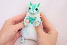 Little dragon named Willie ! Approximately 3,9 inch (10 cm) in sitting position. - Completely handmade - Made from Faux Fur. - Glass eyes. - Solid parts are made of polymer clay. - Color - pastel, acrylic colors. My dear buyer! If you see that the toy is in stock, then you buy exactly