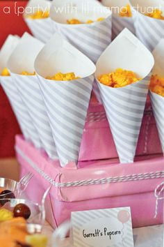 Clever and cheap way to hold cone favors- really not just for girly parties!