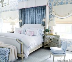 To scale down the lofty master bedroom, Whittaker lined the canopy in Bassett McNab's Interlachen Scroll and papered the walls with Brunschwig & Fils's Malabar Coast. A chest by Mecox exudes glamour. The bed is covered in Templeton's Panna with Samuel & Sons trim. The linens are from Matouk.   - HouseBeautiful.com