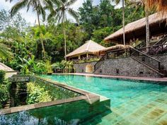Designed to mimic the nearby rice terraces, and let guests feel like they're floating above the trees, the tiered structure at Hanging Gardens Ubud in Bali is one of the world's most photographed resort swimming pools. www.hanginggardensubud.com #ubud #bali #ultimateescape #jungleparadise #bucketlist #takemetherenow #worldsbestpool #hanginggardensubud