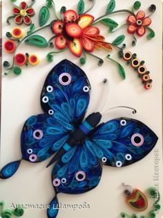 beautiful blue quilled butterfly and flowers
