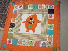 Adorable monster quilt for both baby girl or boy.