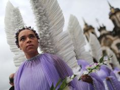 Brazil Participants dressed as angels march in the annual Easter procession during traditional Semana Santa (Holy Week) festivities on April 5, 2015 in Ouro Preto, Brazil.  Holy Week marks Easter celebrations for Catholics, and Brazil holds the largest number of Catholics on the planet.
