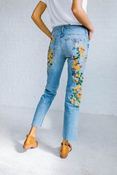 DETAILS: With beautiful and colorful embroidery down the sides, these high-rise jeans are in a girlfriend fit. - Authentic, comfort stretch fabrication - Raw hem - Five-pocket style - Button closure a