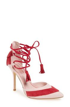 The suede fringe adds a flirty feel to these gorgeous wraparound pumps. <3
