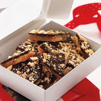 'Butter-Crunch Toffee' from Redbook. Simply delicious (and deliciously simple), our Butter-Crunch Toffee is the perfect gift for anyone on your list. Köstliche Desserts, Holiday Desserts, Holiday Recipes, Delicious Desserts, Dessert Recipes, Holiday Foods, Christmas Recipes, Holiday Fun, Health Desserts