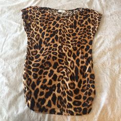 Leopard print stretchy blouse Only worn once. Top is stretchy . Has scrunch on the sides towards bottom. So cute! Tops Blouses