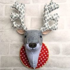 """This little reindeer will make a quirky addition to your Christmas decorations this year! Looking remarkably cheerful, he's mounted on a 6"""" hoop and measures 14"""" from the bottom of his neck to the tips of his antlers. 