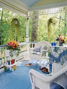 Sweet details, like stripes painted on railing spindles and a bright blue floor, give this porch a distinct look. http://www.ivillage.com/blue-home-decor/7-a-533801