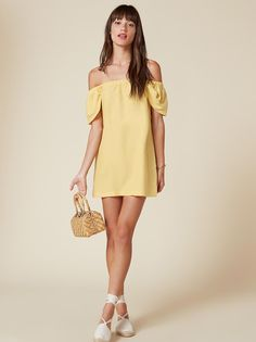 Nice collarbones. This is a mini length, off-the-shoulder dress with an elastic neckline and relaxed fit.