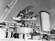 [Photo] Royal Australian Air Force Walrus aircraft being lifted onto a Leander-class light cruiser, 1939 Amphibious Aircraft, Navy Aircraft, Ww2 Aircraft, Military Aircraft, Royal Australian Navy, Royal Australian Air Force, Australian Defence Force, Float Plane, Naval History