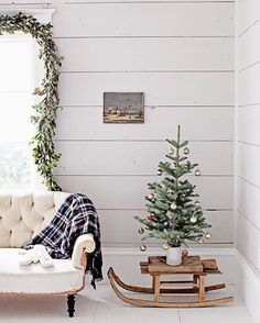 One of my favorite ways to display a vintage French sled during the holidays. {It is available under French Farmhouse Christmas Collection, the link is in our profile}