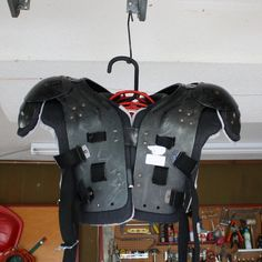 football pads hanger made from dowel and bike hook