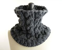 Chunky cowl with knit cables.