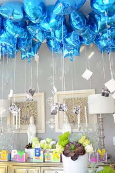 #birthdayballoons with #hangingphotos #blueballoons
