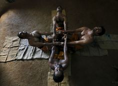 Colombo, Sri Lanka - Students stretch during a traditional Angampora martial arts training session