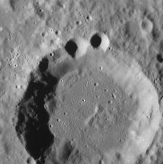 This image of craters on the surface of Mercury, taken by NASA's MESSENGER spacecraft, bears resemblance to the Cookie Monster.  To learn more about the strange and wonderful features of the planet Mercury, check out a free lecture at the National Air and Space Museum next Saturday, October 20th: http://airandspace.si.edu/events/eventDetail.cfm?eventID=4306  Afterward, visit the Public Observatory for evening observing! http://airandspace.si.edu/events/eventDetail.cfm?eventID=4395