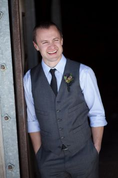 I like this look...black tie and grey vest is very classic!