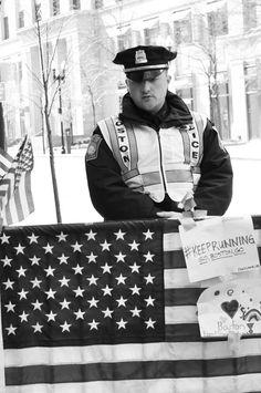 #Boston Police Officer at Marathon Memorial #BostonStrong