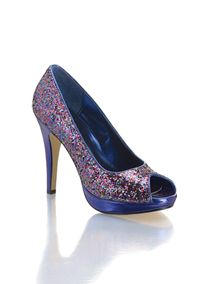 "You'll amaze all your friends wearing these brilliant multi colored glitter platform pumps. Fashion forward peep-toe with a metallic ""royal-purple"" heel and base. 4 1/4"" heel with a 1"" platform for added height. Manmade upper and sole. Imported. Sizzle by Coloriffics."