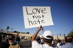 "A demonstrator holds sign at ""Freedom of Speech Rally Round II"" across street from Islamic Community Center in Phoenix, Arizona"