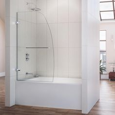 The AQUA UNO is a single panel swing tub door with a sophisticated curved silhouette. Solid brass wall-to-glass hinges provide a frameless design, while the easy to reach towel bar doubles as a handle.
