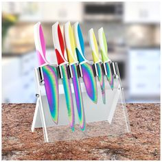 Add color to your kitchen. With rainbow blades, this set is much more appealing with palm trees, sailboats and islands etched in the blades. Check it out==>  http://gwyl.io/colorful-titanium-kitchen-knives/