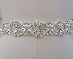 Pearls and crystals wedding dress sash. High quality by StevenBridal on Etsy https://www.etsy.com/listing/256092531/pearls-and-crystals-wedding-dress-sash