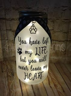 Pet Memorial Frosted Mason Jar Light Please note actual color may vary from photos due to the resolution of your computer, tablet, and phone screens. Saying on jar: You have left my life, but you will never leave my heart (saying is vinyl) Mason Jar is Pet Memorial Jewelry, Pet Memorial Stones, Pet Memorial Gifts, Dog Memorial, Mason Jar Gifts, Mason Jar Diy, Dog Shadow Box, Diy Pet, Frosted Mason Jars