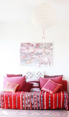 Red and pink with an awesome ethnic blanket as bed cover