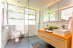 bathroom with floating vanity and glass shower