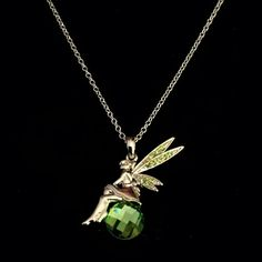 NWOT PERIDOT-CRYSTAL FAIRY NECKLACE NWOT FAIRY ~ Has peridot wings sitting on peridot stone unbranded Jewelry Necklaces