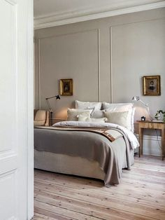 There's something about the simplicity and elegance of this bedroom. I think I would want the bed to have a headboard, though.