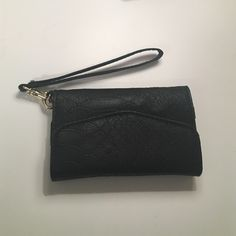 Wallet Case Black/leather textured wallet/phone case. Great condition. Never used. Fits an iPhone 5 Accessories Key & Card Holders