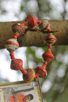 Haitian artists who are trying to secure basic needs for their children and themselves, recycle magazines and cereal boxes to make these unique beads. Please purchase one (or more) to support Haiti and adoption.