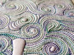 Tips for free motion quilting on a sewing machine; including ruler work: using rulers to guide free motion quilting, doodle quilting, & quilt design.